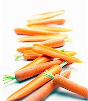 Carrots, whole and halved Stock Photo - Premium Royalty-Freenull, Code: 659-06306795