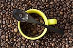 An espresso cup and a spoon on a pile of coffee beans Stock Photo - Premium Royalty-Free, Artist: Ron Fehling, Code: 659-06307166