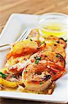 Shrimp Scampi on a Dish with Lemon; Butter Dipping Sauce Stock Photo - Premium Royalty-Free, Artist: Cultura RM, Code: 659-06307247