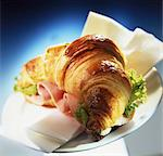 A croissant with ham and lettuce Stock Photo - Premium Royalty-Free, Artist: Blend Images, Code: 659-06307304