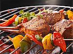 Vegetable kebabs and ribs on a barbecue Stock Photo - Premium Royalty-Freenull, Code: 659-06307337