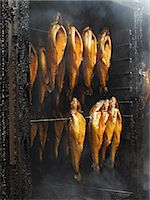 smoked - Trout being smoked Stock Photo - Premium Royalty-Freenull, Code: 659-06307351