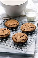 Fresh Homemade Molasses Cookies on a Cooling Rack; Glass of Milk Stock Photo - Premium Royalty-Freenull, Code: 659-06307604