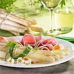 Asparagus with ham, egg and chamomile flowers and white wine Stock Photo - Premium Royalty-Free, Artist: Susan Findlay, Code: 659-06307622