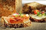 Slices of wholemeal bread topped with ham, herb quark and vegetables Stock Photo - Premium Royalty-Free, Artist: CulturaRM, Code: 659-06307652