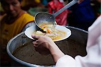 south american woman - A woman serving soup at a market Stock Photo - Premium Royalty-Freenull, Code: 6106-06307924
