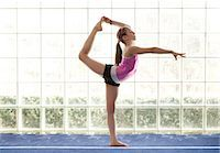 preteen girls gymnastics - young gymnast holding leg above head Stock Photo - Premium Royalty-Freenull, Code: 6106-06308086