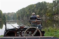 Senior couple looking at lake, in front of antique car Stock Photo - Premium Royalty-Freenull, Code: 6106-06309187