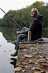 Senior man fishing from pier Stock Photo - Premium Royalty-Free, Artist: George Shelley, Code: 6106-06309210