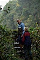 Senior couple walking up steps Stock Photo - Premium Royalty-Freenull, Code: 6106-06309225