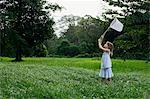 young girl chasing butterflies with net Stock Photo - Premium Royalty-Free, Artist: Aurora Photos            , Code: 6106-06309604