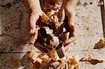 Close up of man holding wooden shavings. Stock Photo - Premium Royalty-Free, Artist: Andrew Wenzel, Code: 6106-06309877