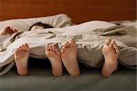 Feet of man and woman in bed Stock Photo - Premium Royalty-Freenull, Code: 6106-06309968