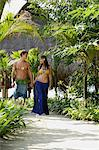 young tropical couple walking on path Stock Photo - Premium Royalty-Free, Artist: R. Ian Lloyd, Code: 6106-06310816