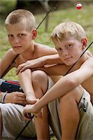 young boys with fishing gear Stock Photo - Premium Royalty-Freenull, Code: 6106-06310906