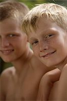preteen boy shirtless - two young boys Stock Photo - Premium Royalty-Freenull, Code: 6106-06310909