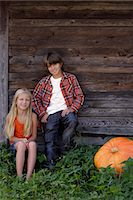 preteen long hair - boy and girl with pumpkin Stock Photo - Premium Royalty-Freenull, Code: 6106-06311273