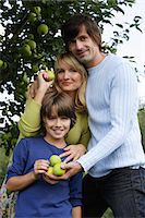 family apple orchard - family under apple tree Stock Photo - Premium Royalty-Freenull, Code: 6106-06311295