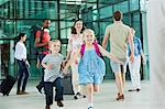 Excited children running on airport concourse Stock Photo - Premium Royalty-Free, Artist: AlaskaStock, Code: 614-06311624