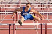 Male hurdler clearing hurdles Stock Photo - Premium Royalty-Freenull, Code: 614-06311627