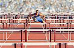 Male hurdler clearing hurdles Stock Photo - Premium Royalty-Free, Artist: Aflo Sport, Code: 614-06311629