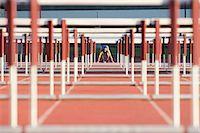 Male hurdler at starting line Stock Photo - Premium Royalty-Freenull, Code: 614-06311632