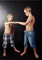 Brothers doing high five with fists Stock Photo - Premium Royalty-Freenull, Code: 614-06311725