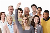 Group of people, woman with arm raised Stock Photo - Premium Royalty-Freenull, Code: 614-06311759