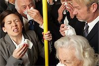 people coughing or sneezing - Businesspeople sneezing on subway train Stock Photo - Premium Royalty-Freenull, Code: 614-06311801