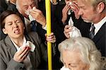 Businesspeople sneezing on subway train Stock Photo - Premium Royalty-Freenull, Code: 614-06311801