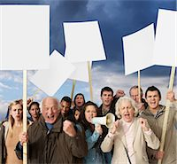 Group of angry protesters holding blank banners Stock Photo - Premium Royalty-Freenull, Code: 614-06311805