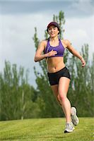 Young woman running in park Stock Photo - Premium Royalty-Freenull, Code: 614-06311866