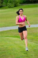 Young woman running in park Stock Photo - Premium Royalty-Freenull, Code: 614-06311872