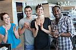 Four people clapping in office interior Stock Photo - Premium Royalty-Free, Artist: Blend Images, Code: 614-06311939