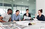 Colleagues planning during creative meeting Stock Photo - Premium Royalty-Free, Artist: Blend Images, Code: 614-06311950