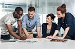 Colleagues planning during creative meeting Stock Photo - Premium Royalty-Free, Artist: Blend Images, Code: 614-06311962