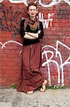 Young woman against wall of graffiti Stock Photo - Premium Royalty-Free, Artist: Uwe Umstätter, Code: 614-06312058