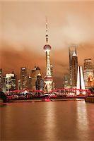 Skyline of Lujiazui Pudong viewed from Suzhou river at night, Shanghai, China Stock Photo - Premium Rights-Managednull, Code: 855-06312228