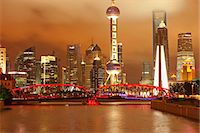 Skyline of Lujiazui Pudong viewed from Suzhou river at night, Shanghai, China Stock Photo - Premium Rights-Managednull, Code: 855-06312231