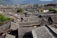 Residential rooftops at the ancient city of Lijiang, Yunnan Province, China Stock Photo - Premium Rights-Managednull, Code: 855-06313049