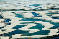 Sandy dunes and lagoons, part of Parque Nacional dos Lencois Maranhenses, Brazil Stock Photo - Premium Rights-Managednull, Code: 855-06313097