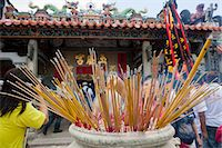 Worshipper offering incense at Pak Tai Temple during the Bun festival, Cheung Chau, Hong Kong Stock Photo - Premium Rights-Managednull, Code: 855-06313352