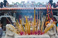 Worshipper offering incense at Pak Tai Temple during the Bun festival, Cheung Chau, Hong Kong Stock Photo - Premium Rights-Managednull, Code: 855-06313353