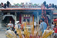 Worshipper offering incense at Pak Tai Temple during the Bun festival, Cheung Chau, Hong Kong Stock Photo - Premium Rights-Managednull, Code: 855-06313354