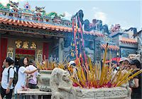 Worshippers offering incense at Pak Tai Temple during the Bun festival, Cheung Chau, Hong Kong Stock Photo - Premium Rights-Managednull, Code: 855-06313357