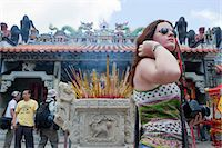Foreign visitors sharing the atmosphere of the Bun festival at Pak Tai Temple, Cheung Chau, Hong Kong Stock Photo - Premium Rights-Managednull, Code: 855-06313358