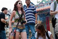 Foreign visitors sharing the atmosphere of the Bun festival at Pak Tai Temple, Cheung Chau, Hong Kong Stock Photo - Premium Rights-Managednull, Code: 855-06313360