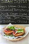 Smoked salmon,cheese,tomato and caper bagel sandwich Stock Photo - Premium Rights-Managed, Artist: Photocuisine, Code: 825-06316537