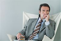 Mature businessman relaxing with drink and cigar Stock Photo - Premium Royalty-Freenull, Code: 632-06317192