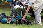 Campers unloading camping gear, low section Stock Photo - Premium Royalty-Free, Artist: Westend61, Code: 632-06317218